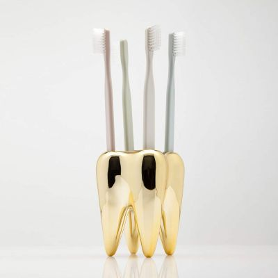 Badkamer - Gouden tand tandenborstelhouder